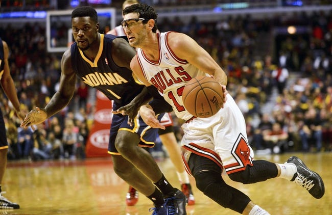 Oct 18, 2013; Chicago, IL, USA; Chicago Bulls guard Kirk Hinrich dribbles against the Indiana Pacers guard Lance Stephenson at the United Center. Mandatory Credit: Matt Marton-USA TODAY Sports