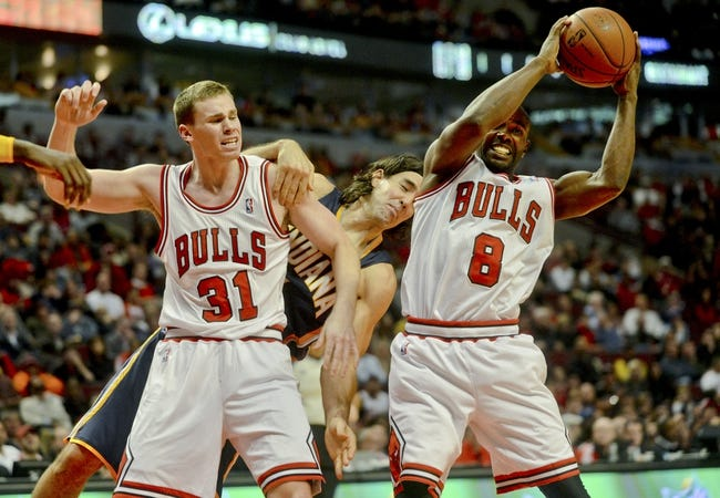 Oct 18, 2013; Chicago, IL, USA; Indiana Pacers forward Luis Scola fights for a ball against Chicago Bulls forward Erik Murphy and guard Mike James at the United Center. Mandatory Credit: Matt Marton-USA TODAY Sports