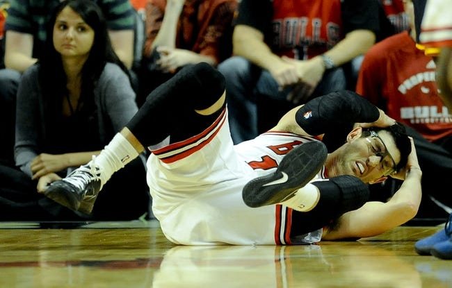 Oct 18, 2013; Chicago, IL, USA; Chicago Bulls guard Kirk Hinrich holds his head after he hits the ground against the Indiana Pacers at the United Center. Mandatory Credit: Matt Marton-USA TODAY Sports