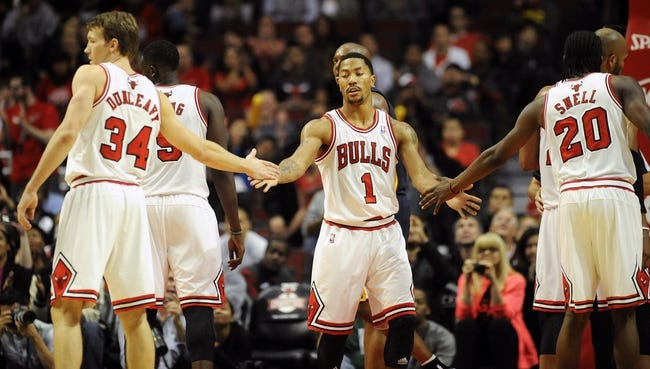 Oct 18, 2013; Chicago, IL, USA; Chicago Bulls guard Derrick Rose high-fives guard Mike Dunleavy and forward Tony Snell against the Indiana Pacers at the United Center. Mandatory Credit: Matt Marton-USA TODAY Sports