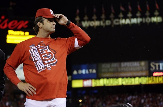 Oct 18, 2013; St. Louis, MO, USA; St. Louis Cardinals manager Mike Matheny tips his cap to the crowd after game six of the National League Championship Series baseball game against the Los Angeles Dodgers at Busch Stadium. Mandatory Credit: David J. Phillip/Pool Photo via USA TODAY Sports