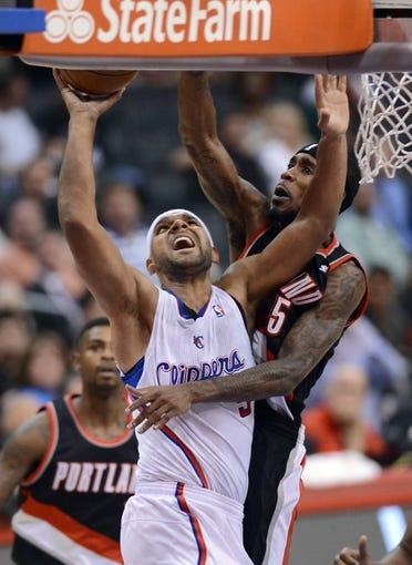 Oct 18, 2013; Los Angeles, CA, USA; Portland Trail Blazers shooting guard Will Barton (5) defends Los Angeles Clippers shooting guard Jared Dudley (9) in the second quarter of the game at the Staples Center. Mandatory Credit: Jayne Kamin-Oncea-USA TODAY Sports