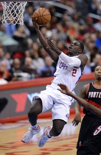 Oct 18, 2013; Los Angeles, CA, USA;  Los Angeles Clippers point guard Darren Collison (2) makes a layup in the second quarter of the game against the Portland Trail Blazers at the Staples Center. Mandatory Credit: Jayne Kamin-Oncea-USA TODAY Sports