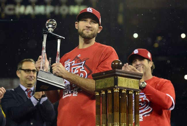 Oct 18, 2013; St. Louis, MO, USA; St. Louis Cardinals starting pitcher Michael Wacha holds the series MVP trophy after game six of the National League Championship Series baseball game against the Los Angeles Dodgers at Busch Stadium. Mandatory Credit: Jeff Curry-USA TODAY Sports