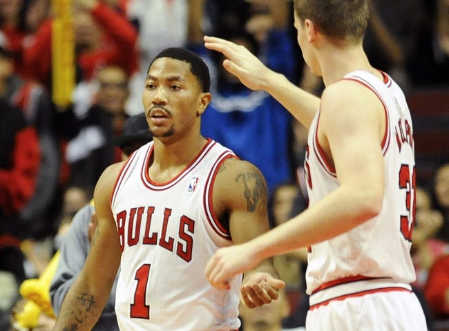 Oct 18, 2013; Chicago, IL, USA; Chicago Bulls guard Derrick Rose  gets a high-five from guard Mike Dunleavy against the Indiana Pacers at the United Center. Mandatory Credit: Matt Marton-USA TODAY Sports