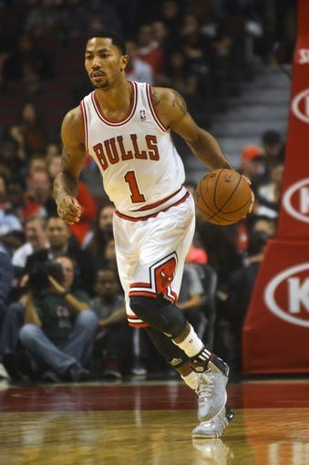 Oct 18, 2013; Chicago, IL, USA; Chicago Bulls guard Derrick Rose dribbles against the Indiana Pacers at the United Center. Mandatory Credit: Matt Marton-USA TODAY Sports