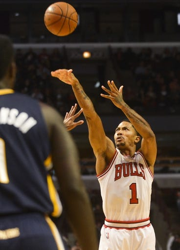Oct 18, 2013; Chicago, IL, USA; Chicago Bulls guard Derrick Rose shoots against the Indiana Pacers at the United Center. Mandatory Credit: Matt Marton-USA TODAY Sports