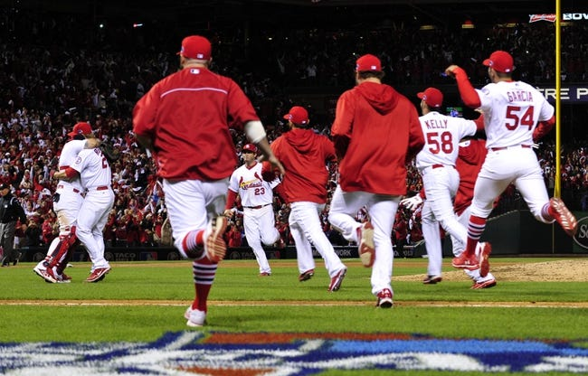 Oct 18, 2013; St. Louis, MO, USA; St. Louis Cardinals players run onto the field to celebrate with Yadier Molina (left) and Trevor Rosenthal (second from left) after game six of the National League Championship Series baseball game against the Los Angeles Dodgers at Busch Stadium. Mandatory Credit: Scott Rovak-USA TODAY Sports