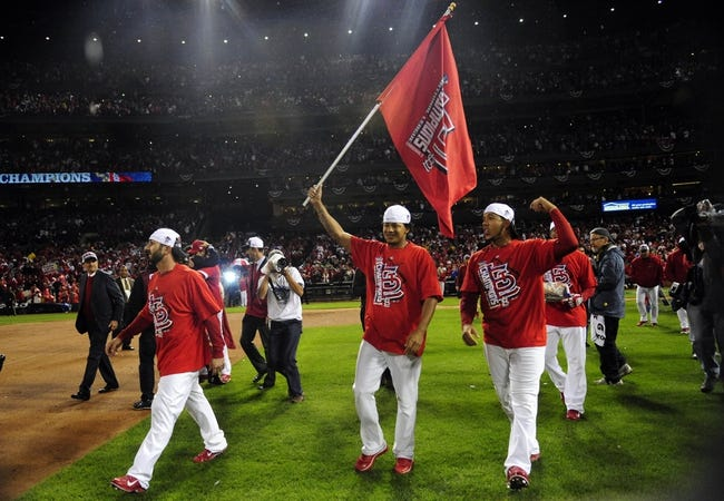 Oct 18, 2013; St. Louis, MO, USA; St. Louis Cardinals players from left Daniel Descalso , Carlos Martinez and Jon Jay celebrate after game six of the National League Championship Series baseball game against the Los Angeles Dodgers at Busch Stadium. Mandatory Credit: Jeff Curry-USA TODAY Sports