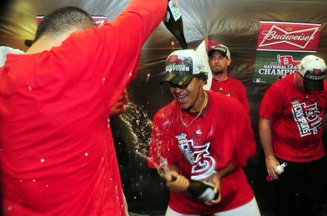 Oct 18, 2013; St. Louis, MO, USA; St. Louis Cardinals relief pitcher Carlos Martinez celebrates in the clubhouse after game six of the National League Championship Series baseball game against the Los Angeles Dodgers at Busch Stadium. Mandatory Credit: Jeff Curry-USA TODAY Sports