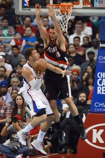 Oct 18, 2013; Los Angeles, CA, USA; Portland Trail Blazers power forward Joel Freeland (19) defends Los Angeles Clippers power forward Blake Griffin (32) in the second half of the game at the Staples Center. Mandatory Credit: Jayne Kamin-Oncea-USA TODAY Sports