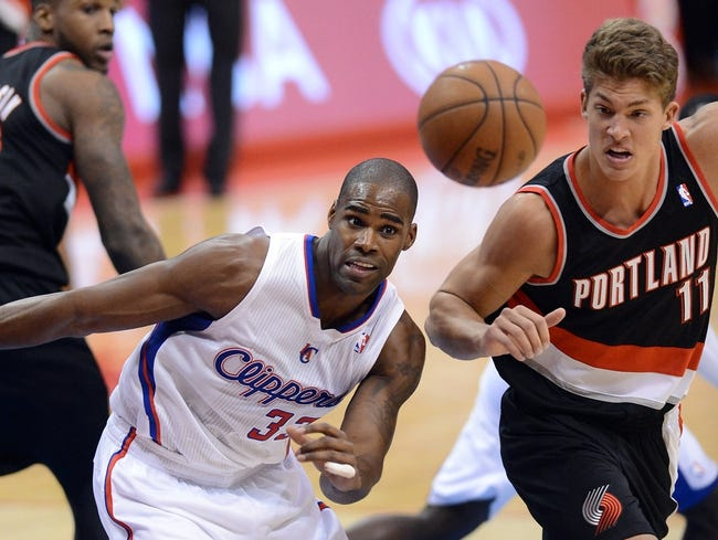 Oct 18, 2013; Los Angeles, CA, USA; Los Angeles Clippers power forward Antawn Jamison (33) and Portland Trail Blazers center Meyers Leonard (11) go for a rebound in the second half of the game at the Staples Center. Mandatory Credit: Jayne Kamin-Oncea-USA TODAY Sports
