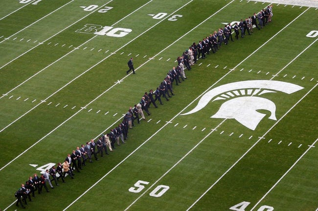 Oct 19, 2013; East Lansing, MI, USA; Michigan State Spartans walk the field as a team prior to a game against the Indiana Hoosiers at Spartan Stadium. Mandatory Credit: Mike Carter-USA TODAY Sports