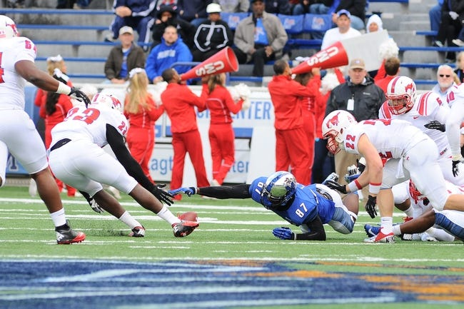 Oct 19, 2013; Memphis, TN, USA; Memphis Tigers wide receiver Tevin Jones (87) reaches for the ball after a fumble against Southern Methodist Mustangs linebacker Stephon Sanders (23) during the first quarter at Liberty Bowl Memorial. Mandatory Credit: Justin Ford-USA TODAY Sports