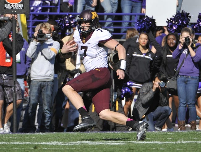 Oct 19, 2013; Evanston, IL, USA; Minnesota Golden Gophers quarterback Mitch Leidner (7) runs for yardage against the Northwestern Wildcats during the first quarter Ryan Field. Mandatory Credit: David Banks-USA TODAY Sports