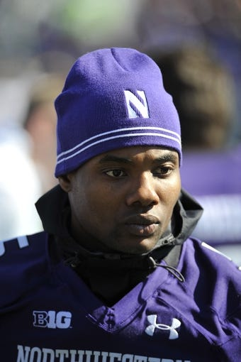 Oct 19, 2013; Evanston, IL, USA; Northwestern Wildcats running back Venric Mark (5) stands on the sidelines during a game against the Minnesota Golden Gophers at Ryan Field. Mandatory Credit: David Banks-USA TODAY Sports