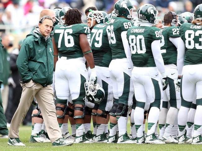 Oct 19, 2013; East Lansing, MI, USA; Michigan State Spartans head coach Mark Dantonio walks the sidelines in between plays during the 1st  half of game against the Purdue Boilermakers at Spartan Stadium. Mandatory Credit: Mike Carter-USA TODAY Sports
