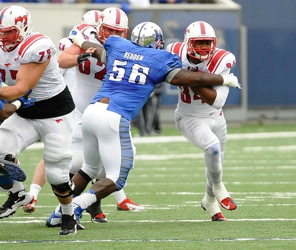 Oct 19, 2013; Memphis, TN, USA; Memphis Tigers defensive lineman Terry Redden (56) tries to bring down Southern Methodist Mustangs running back Traylon Shead (34) during the second quarter at Liberty Bowl Memorial. Mandatory Credit: Justin Ford-USA TODAY Sports