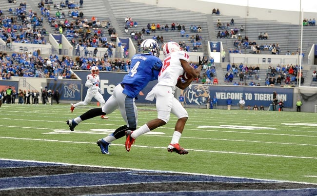 Oct 19, 2013; Memphis, TN, USA; Southern Methodist Mustangs wide receiver Jeremy Johnson (15) catches a pass thrown by Southern Methodist Mustangs quarterback Garrett Gilbert (11) not pictured during the second quarter at Liberty Bowl Memorial. Mandatory Credit: Justin Ford-USA TODAY Sports