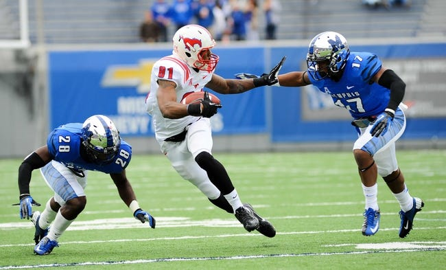 Oct 19, 2013; Memphis, TN, USA; Southern Methodist Mustangs wide receiver Keenan Holman (81) stiff arms Memphis Tigers defensive back Chris Morley (17) at Liberty Bowl Memorial. Mandatory Credit: Justin Ford-USA TODAY Sports