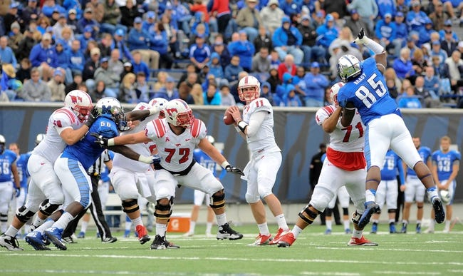 Oct 19, 2013; Memphis, TN, USA; Southern Methodist Mustangs quarterback Garrett Gilbert (11) looks to pass against Memphis Tigers during the second quarter at Liberty Bowl Memorial. Mandatory Credit: Justin Ford-USA TODAY Sports