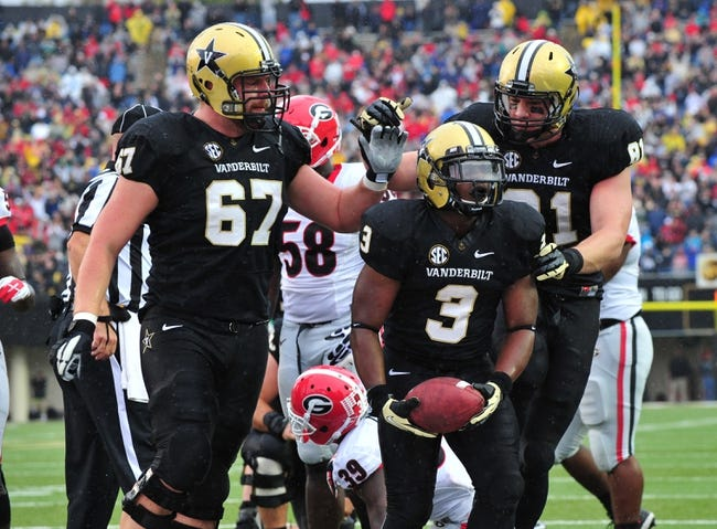 Oct 19, 2013; Nashville, TN, USA; Vanderbilt Commodores running back Jerron Seymour (3) celebrates with lineman Wesley Johnson (67) and tight end Steven Scheu (81) after Seymour scored a touchdown against the Georgia Bulldogs during the first half at Vanderbilt Stadium. Mandatory Credit: Don McPeak-USA TODAY Sports