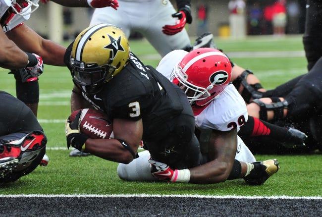 Oct 19, 2013; Nashville, TN, USA; Vanderbilt Commodores running back Jerron Seymour (3) scores a touchdown against Georgia Bulldogs safety Corey Moore (39) during the first half at Vanderbilt Stadium. Mandatory Credit: Don McPeak-USA TODAY Sports