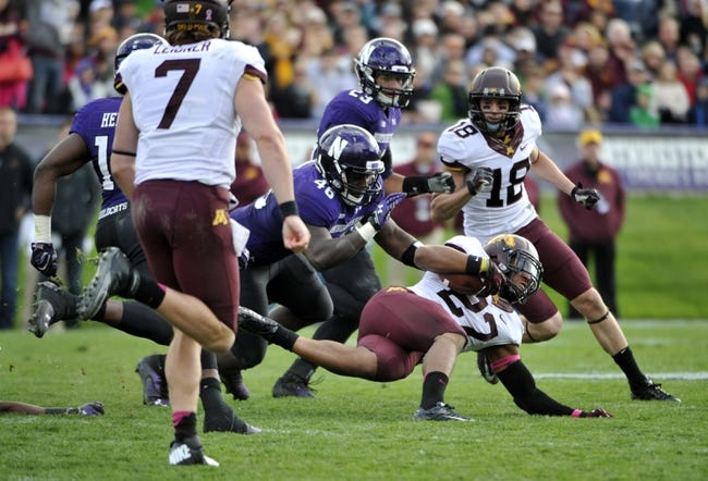 Oct 19, 2013; Evanston, IL, USA; Minnesota Golden Gophers running back David Cobb (27) is tackled by Northwestern Wildcats linebacker Damien Proby (46) during the second half at Ryan Field.  The Minnesota Golden Gophers defeated the Northwestern Wildcats 20-17. Mandatory Credit: David Banks-USA TODAY Sports