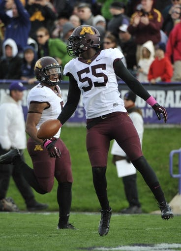 Oct 19, 2013; Evanston, IL, USA; Minnesota Golden Gophers defensive lineman Theiren Cockran (55)  celebrates after causing Northwestern Wildcats quarterback Trevor Siemian (not pictured) to fumble during the second half at Ryan Field.  The Minnesota Golden Gophers defeated the Northwestern Wildcats 20-17. Mandatory Credit: David Banks-USA TODAY Sports