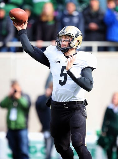 Oct 19, 2013; East Lansing, MI, USA; Purdue Boilermakers quarterback Danny Etling (5) attempts to throw the ball against the Michigan State Spartans  during the 2nd half at Spartan Stadium. MSU won 14-0. Mandatory Credit: Mike Carter-USA TODAY Sports
