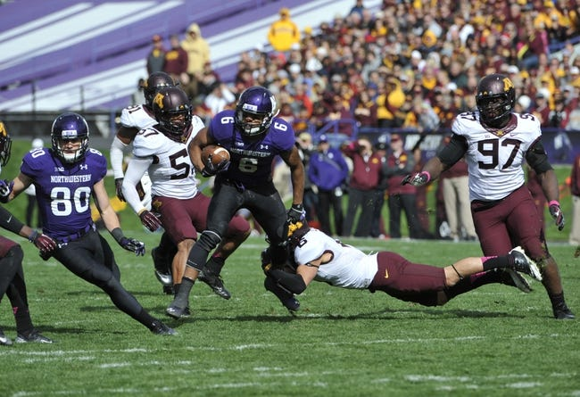 Oct 19, 2013; Evanston, IL, USA; Northwestern Wildcats wide receiver Tony Jones (6) runs and is tackled by Minnesota Golden Gophers defensive back Grayson Levine (6) during the second half at Ryan Field.  The Minnesota Golden Gophers defeated the Northwestern Wildcats 20-17. Mandatory Credit: David Banks-USA TODAY Sports