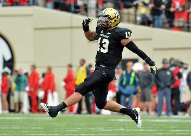 Oct 19, 2013; Nashville, TN, USA; Vanderbilt Commodores linebacker Jake Sealand (13) celebrates after the Commodores recovered a Georgia Bulldogs fumble late in the second half at Vanderbilt Stadium. The Commodores beat the Bulldogs 31-27. Mandatory Credit: Don McPeak-USA TODAY Sports