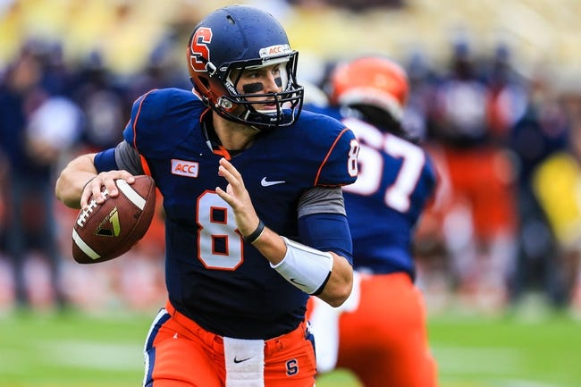 Oct 19, 2013; Atlanta, GA, USA; Syracuse Orange quarterback Drew Allen (8) rolls out on a play in the second half against Georgia Tech Yellow Jackets at Bobby Dodd Stadium. Georgia Tech won 56-0. Mandatory Credit: Daniel Shirey-USA TODAY Sports