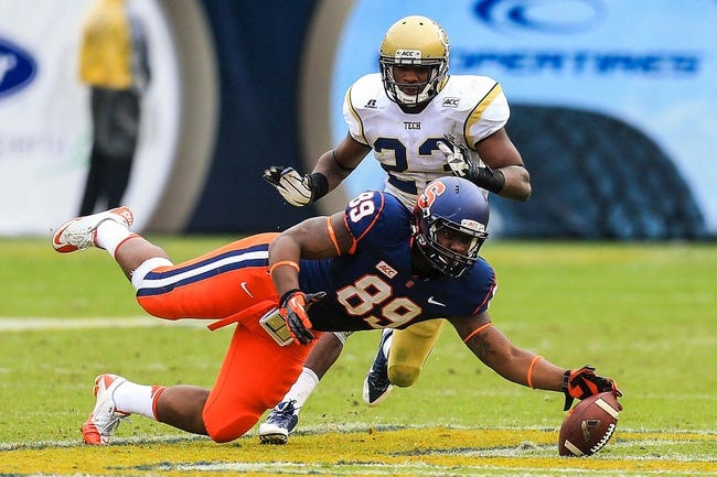 Oct 19, 2013; Atlanta, GA, USA; Syracuse Orange tight end Josh Parris (89) dives for a pass in the second half against the Georgia Tech Yellow Jackets at Bobby Dodd Stadium. Georgia Tech won 56-0. Mandatory Credit: Daniel Shirey-USA TODAY Sports