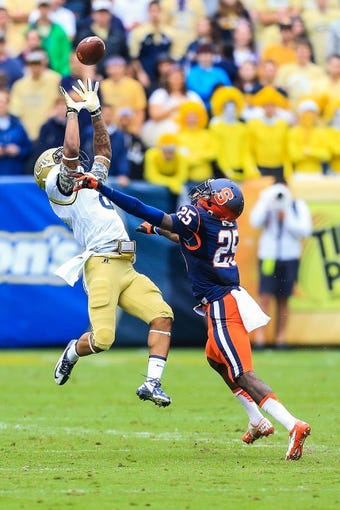 Oct 19, 2013; Atlanta, GA, USA; Georgia Tech Yellow Jackets cornerback Louis Young (8) breaks up a pass intended for Syracuse Orange wide receiver Jeremiah Kobena (25) in the second half at Bobby Dodd Stadium. Georgia Tech won 56-0. Mandatory Credit: Daniel Shirey-USA TODAY Sports