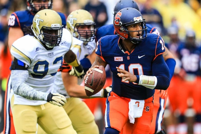 Oct 19, 2013; Atlanta, GA, USA; Syracuse Orange quarterback Terrel Hunt (10) scrambles on a pass play in the first half against the Georgia Tech Yellow Jackets at Bobby Dodd Stadium. Mandatory Credit: Daniel Shirey-USA TODAY Sports