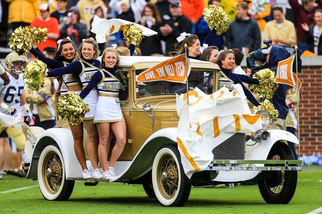 Oct 19, 2013; Atlanta, GA, USA; The Georgia Tech Yellow Jackets cheerleaders on the Ramblin Wreck comes on the field before the game against Syracuse at Bobby Dodd Stadium. Mandatory Credit: Daniel Shirey-USA TODAY Sports