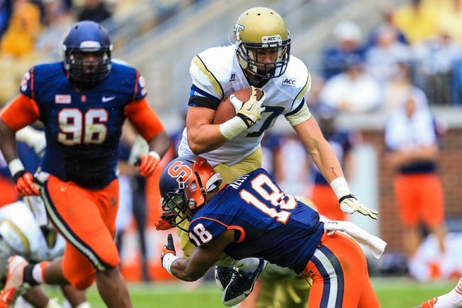 Oct 19, 2013; Atlanta, GA, USA; Georgia Tech Yellow Jackets running back Zach Laskey (37) is tackled by Syracuse Orange defensive back Darius Kelly (18) in the first half at Bobby Dodd Stadium. Mandatory Credit: Daniel Shirey-USA TODAY Sports