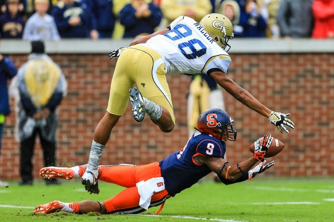 Oct 19, 2013; Atlanta, GA, USA; Syracuse Orange cornerback Ri'Shard Anderson (9) intercepts a pass intended for Georgia Tech Yellow Jackets wide receiver Darren Waller (88) in the first half at Bobby Dodd Stadium. Mandatory Credit: Daniel Shirey-USA TODAY Sports