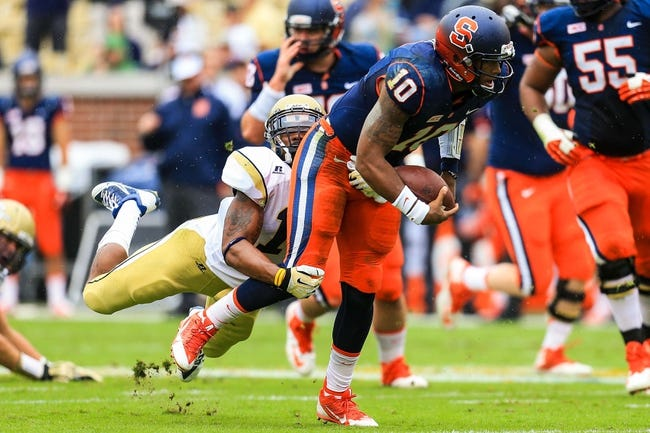 Oct 19, 2013; Atlanta, GA, USA; Syracuse Orange quarterback Terrel Hunt (10) is tackled by Georgia Tech Yellow Jackets safety Isaiah Johnson (1) in the first half at Bobby Dodd Stadium. Mandatory Credit: Daniel Shirey-USA TODAY Sports