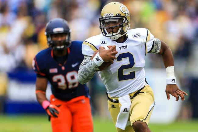 Oct 19, 2013; Atlanta, GA, USA; Georgia Tech Yellow Jackets quarterback Vad Lee (2) runs the ball in the first half against Syracuse at Bobby Dodd Stadium. Mandatory Credit: Daniel Shirey-USA TODAY Sports