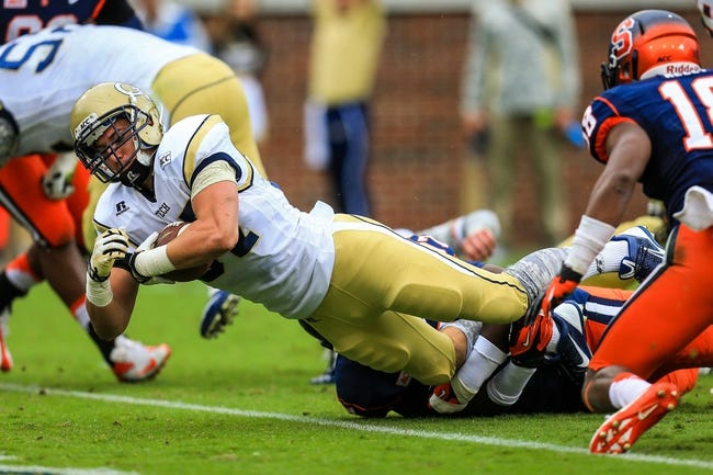 Oct 19, 2013; Atlanta, GA, USA; Georgia Tech Yellow Jackets running back Zach Laskey (37) scores a touchdown in the first half against Syracuse at Bobby Dodd Stadium. Mandatory Credit: Daniel Shirey-USA TODAY Sports
