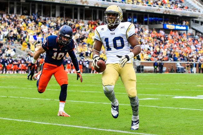Oct 19, 2013; Atlanta, GA, USA; Georgia Tech Yellow Jackets running back Synjyn Days (10) runs the ball for a touchdown in the first half against Syracuse at Bobby Dodd Stadium. Mandatory Credit: Daniel Shirey-USA TODAY Sports
