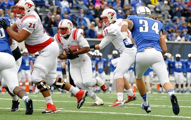 Oct 19, 2013; Memphis, TN, USA; Southern Methodist Mustangs running back Traylon Shead (34) carries the ball against the Memphis Tigers during the third quarter at Liberty Bowl Memorial. Southern Methodist Mustangs defeats Memphis Tigers 34 - 29. Mandatory Credit: Justin Ford-USA TODAY Sports