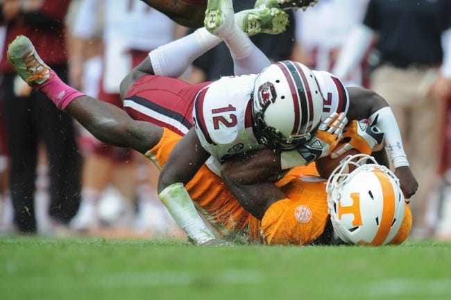Oct 19, 2013; Knoxville, TN, USA; Tennessee Volunteers wide receiver Marquez North (8) is tackled by South Carolina Gamecocks safety Brison Williams (12) during the second half at Neyland Stadium. Tennessee won 23 to 21.  Mandatory Credit: Randy Sartin-USA TODAY Sports