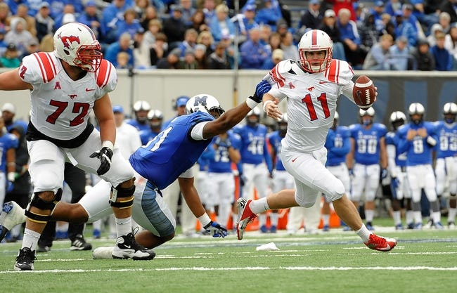 Oct 19, 2013; Memphis, TN, USA; Southern Methodist Mustangs quarterback Garrett Gilbert (11) scrambles against Memphis Tigers defensive lineman Ricky Hunter (91) during the third quarter at Liberty Bowl Memorial. Southern Methodist Mustangs defeats Memphis Tigers 34 - 29. Mandatory Credit: Justin Ford-USA TODAY Sports
