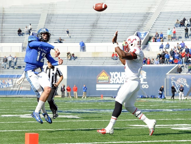 Oct 19, 2013; Memphis, TN, USA; Memphis Tigers quarterback Paxton Lynch (12) throws the ball during the fourth quarter against Southern Methodist Mustangs at Liberty Bowl Memorial. Southern Methodist Mustangs defeats Memphis Tigers 34 - 29. Mandatory Credit: Justin Ford-USA TODAY Sports