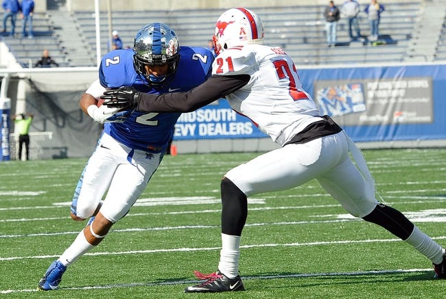 Oct 19, 2013; Memphis, TN, USA; Memphis Tigers wide receiver Joe Craig (2) is tackled by Southern Methodist Mustangs defensive back Kenneth Acker (21) during the fourth quarter  at Liberty Bowl Memorial. Southern Methodist Mustangs defeats Memphis Tigers 34 - 29. Mandatory Credit: Justin Ford-USA TODAY Sports