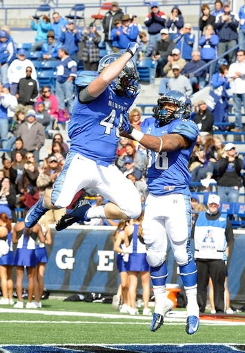 Oct 19, 2013; Memphis, TN, USA; Memphis Tigers running back Brandon Hayes (38) and long snapper Trevor Morgan (41) celebrate after a touchdown against the Southern Methodist Mustangs during the fourth quarter at Liberty Bowl Memorial. Southern Methodist Mustangs defeats Memphis Tigers 34 - 29. Mandatory Credit: Justin Ford-USA TODAY Sports