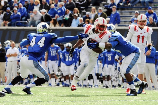 Oct 19, 2013; Memphis, TN, USA; Southern Methodist Mustangs running back Traylon Shead (34) carries the ball against Memphis Tigers during the fourth quarter at Liberty Bowl Memorial. Southern Methodist Mustangs defeats Memphis Tigers 34 - 29. Mandatory Credit: Justin Ford-USA TODAY Sports